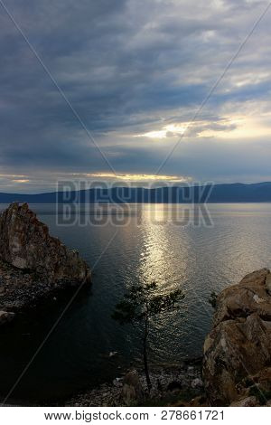 Dark Landscape Of The Last Colors Of The Evening On Cape Burkhan At The Olkhon Island On Baikal Lake