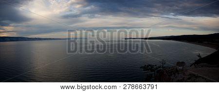 Dark Landscape Of The Last Colors Dusk On Cape Burkhan At The Olkhon Island On Baikal Lake. Summer V