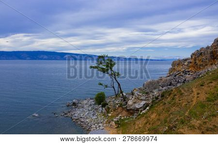Evening View With Cape Burkhan At The Olkhon Island On Small Sea Of Baikal Lake. Summer Vacation In