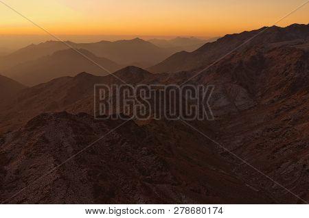 Beautiful morning landscape of Mount Sinai (Mount Horeb, Gabal Musa, Moses Mount) during sunrise. Sinai Peninsula of Egypt. Pilgrimage place and famous touristic destination. poster