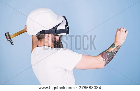 Builder And Renovation Concept. Hipster Busy With Renovation In Virtual Reality. Guy With Hmd Hammer