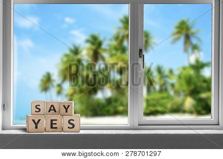 Say Yes Sign In A Window On A Tropical Beach With Palm Trees In The Summer Sun