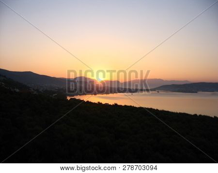 Harmonious View Of Colorful Dawning At The Adriatic Coast