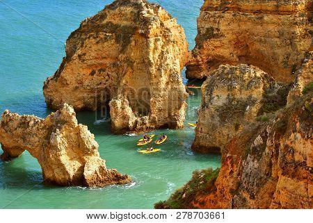 Ponta Da Piedade, Algarve, Portugal - January 13, 2009 : Tourists Kayaking Through The Spectacular R