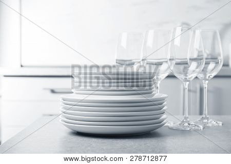 Set Of Clean Dishes On Table In Kitchen