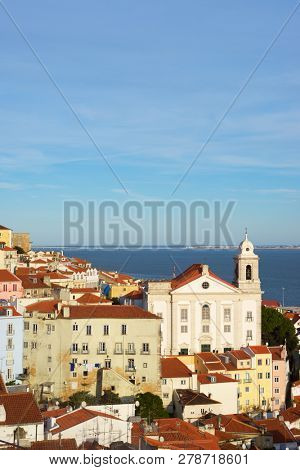 Alfama downtown and Santo Estevao Church in Lisbon, Portugal.