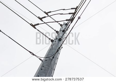 Power Line Union On A Steel Tower With White Sky