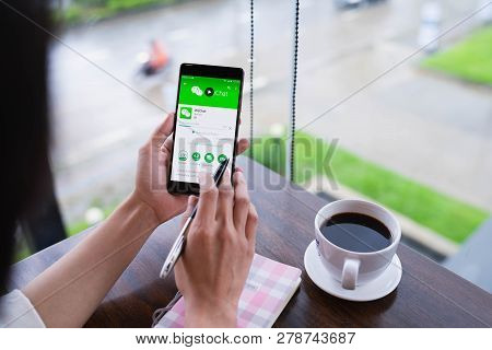 Chiang Mai, Thailand - August 18,2018: Woman Holding Huawei With Wechat  On The Screen.wechat Is A C