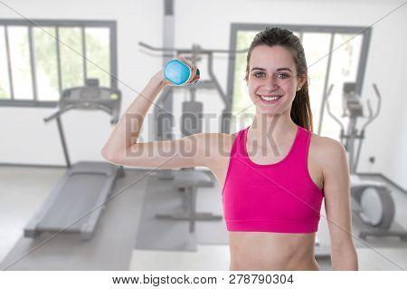 Fitness Girl With Blue Dumbbell Training Exercise