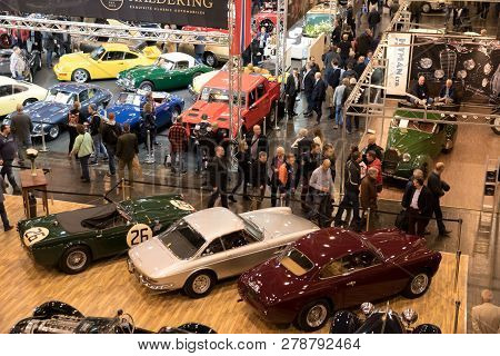 Essen, Germany - Mar 23, 2018: Visitors Viewing The Classic Cars Showcased At The Techno Classica Es