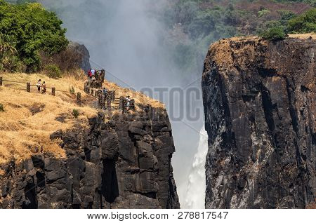 Victoria Falls At Zambia Side, One Of Most Iconic African Natural Landmarks. Zambezi River And Canyo