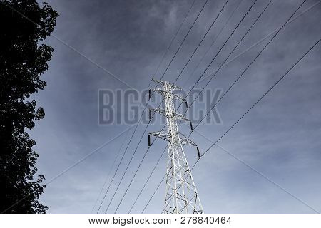 Electricity Pole Against Blue Sky Clouds, Transmission Line Of Electricity To Rural, High Voltage El