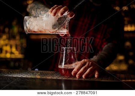 Mixologist Pouring Fresh And Tasty Cool Bittersweet Red Cocktail