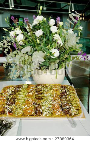 The big pizza and white flowers