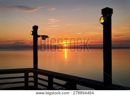 Fraser River Pier Sunrise. Sunrise From The No. 3 Road Fishing Pier In Richmond In The Early Morning