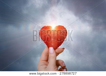 An Isolated Female Hand Is Holding A Bright Red Knitted Heart Inside The Digital Connections Cage Wi