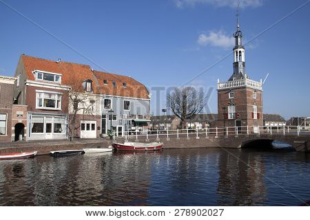 Alkmaar, The Netherlands - Maart 16: Historic Buildings In  Alkmaar With A Tower On The Water With B
