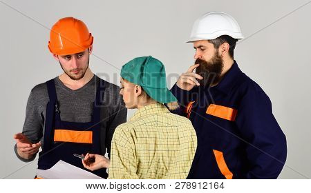 Creating Reality. Construction Workers Team. Men And Woman Builders Working In Team. Group Of Constr