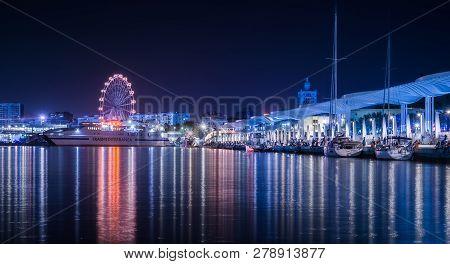 Malaga, Spain - August 10, 2018. Ferris Wheel, Ferryboat Trasmediterranea And Malaga Port Promenade