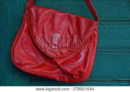 Blank Red Leather Jacket Hanging On Green Wooden Wall