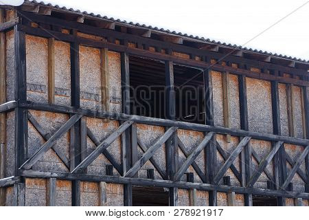 Facade Of Old Gray Brown Old Wooden House With Empty Window