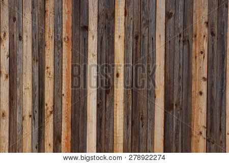 Gray Brown Wooden Background From A Row Of Planks In A Fence Wall