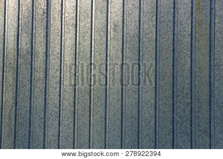 Gray Metal Striped Background From An Old Zinc Wall Fence