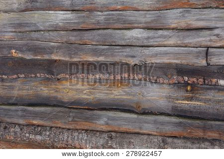 Gray Brown Wooden Background From A Series Of Thin Boards In The Wall Of The Fence