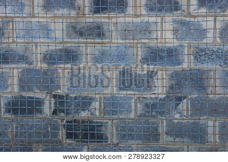 Texture Of Metal Mesh And Gray Bricks In The Wall