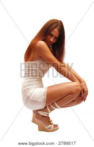 Sunburnt Model In White Dress
