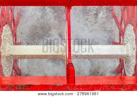 Close Up Of Working Steamboat Paddlewheel With Water