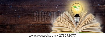 Banner Open Book And Glowing Light Bulb Over It. Knowledge, Education Concept. Panoramic View. Copy