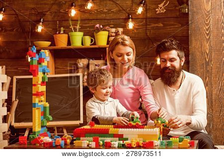 Family Concept. Family Build Structure With Toy Bricks. Family Play With Colorful Bricks. Family Lov