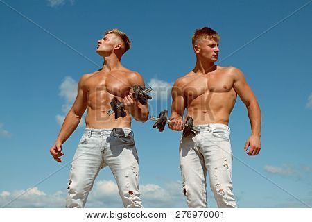 Fight Weakness With Strength. Twins Bodybuilders Develop Strength And Muscles. Twins Men Strength Tr