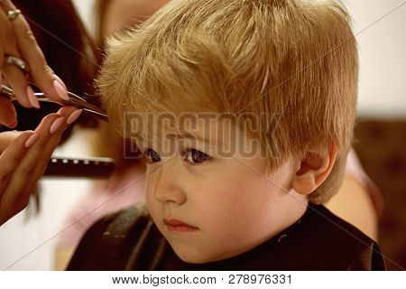 Making Haircut Fun. Little Child Given Haircut. Small Child In Hairdressing Salon. Little Boy With B