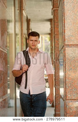 Traveler Man With Travel Bag On Urban Outdoor, Wanderlust. Traveler With Backpack Travel On Vacation