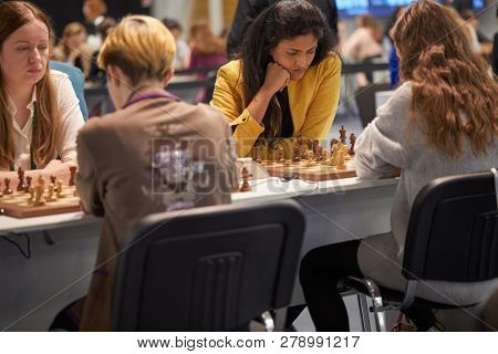 ST. PETERSBURG, RUSSIA - DECEMBER 27, 2018: Grandmaster Harika Dronavalli, India (center) competes in King Salman World Rapid Chess Championship 2018. Eventually she took 14th place