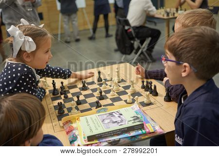ST. PETERSBURG, RUSSIA - DECEMBER 27, 2018: Children playing chess in the hall during World Rapid Chess Championship - 2018. The tournament is supported by King of Saudi Arabia Salman