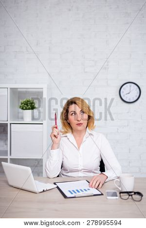 Business Idea Concept - Mature Business Woman Sitting In Office And Thinking About Something - Copy