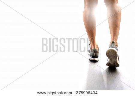 Runner Athlete Feet Running On Road.male Fitness Silhouette Sunlight Jogging Workout Wellness,sport