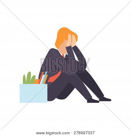Sad Business Man Dismissed From Work, Man Sitting On The Floor With A Box Of Personal Belongings, Of