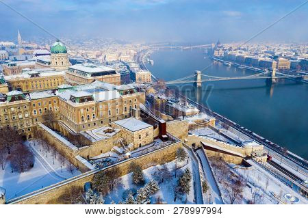 Budapest in winter. Hungary - skyline panorama of Budapest in the winter. The Danube the Parliament the Chain Bridge and the Buda Castle.