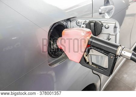 Add Fuel Oil To The Car In The Fuel Gas Station With A Dispenser.(select Focus).