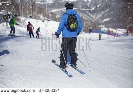 Man Skiing On A Mountain Ski Slope. Winter Rest In The Mountains. Active Lifestyle. Clear Sunny Fros