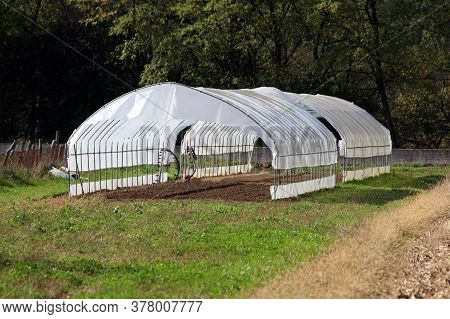 Open Large Garden Greenhouses Made Of Metal Pipes Partially Covered With Semi Transparent Nylon Buil