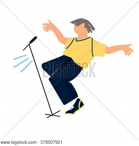 Dancing Male Pop, Rock And Roll Singer By The Stage Microphone. Pop Music Concert. Vocal And Dance P