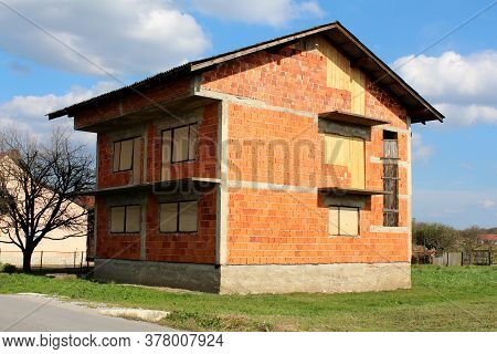 Unfinished Abandoned Red Building Blocks Suburban Family House Without Facade And With Partially Boa