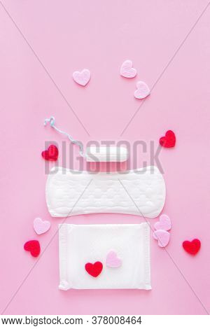 Sanitary Swab And Pads On A Pink Background. An Alternative Choice Of Feminine Hygiene Products. Men