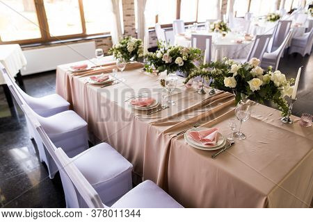 Presidium Table Setting With Empty Wineglasses. Selebration Banquet With Plates And Wineglasses For