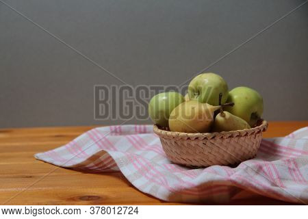 Frail Of Apples And Pears On A Towel On Wooden Table Against Gray Background. Image Contains Copy Sp